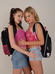 Blonde and Brunette School Girls Displaying Their Horny Activity