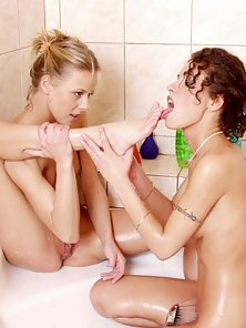 Sweet Babes Licking and Tribbing Shaved Pussy in Bathtub