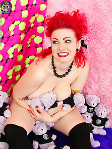 Busty tattooed punk redhead nude and plush