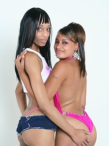 Naughty Ebony Babes Putting an Enormous Dildo in Their Pussies