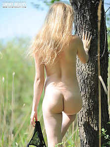 Blonde Lesbian Babe Standing Nudely Under The Tree