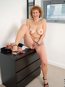 Naughty Granny Posing Her Massive Boobs and Tight Juicy Wet Cunt on Chair