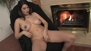 Fabulous sluts making her cunt cum next to a fireplace