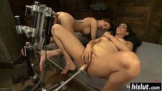 Tattooed hotties try out a bunch of sex toys together