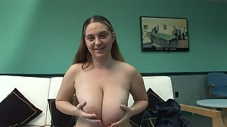 Girl plays with her huge natural tits during an interview