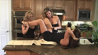 Three curvy babes are having sex in the kitchen