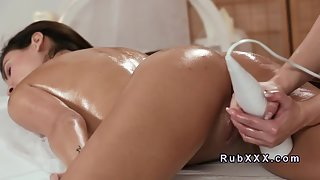 Hot Brunette Chick Takes Massage from Her Masseuse on Table