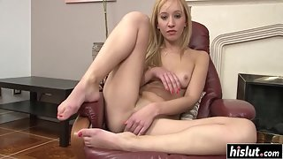 Cute blonde teen fingers her teen pussy on a sofa