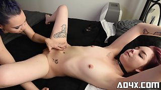 Two tattooed dykes fucking on the bed