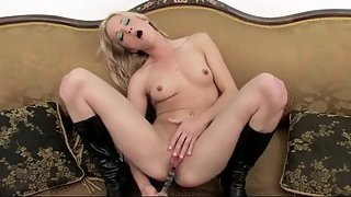 Blonde slut in black boots stuffs glass dildo in wet cunt