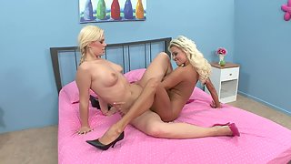 Two blonde babes enjoy oral sex a lot