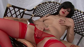 Raven haired hottie in stockings masturbates with black dildo