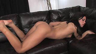 Sexy brunette bitch fingering her cunt at home