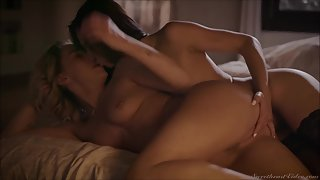 Hot lesbian beauty have passionate sex in the bedroom