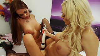 Big titty lesbians are fucking vibrator from both sides