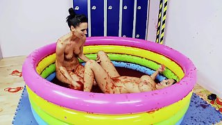 Two sluts in pool filled with cream having fun