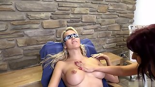 Blindfolded blonde likes how her friend massages her