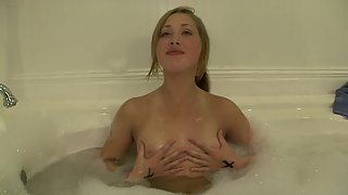 Blonde babe showers and rubs her shaved pussy